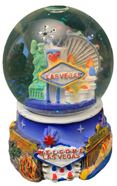 Acrylic base and a Glass Snowglobe. Base is Blue with colorful icons. Inside the snowglobe has glitter snow and colorful 3D versions of the Las Vegas Casinos that you know and love.