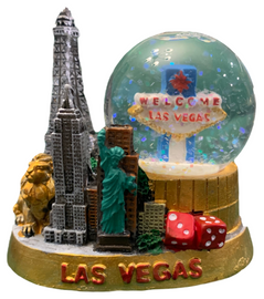 Acrylic Base with Vegas Iconic Casino themes represented outside of the snowglobe portion of this unique gift.