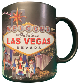 Oversized Las Vegas ceramic coffee mug with a Las Vegas Sign and city Scene design shown on a black mug, side view.