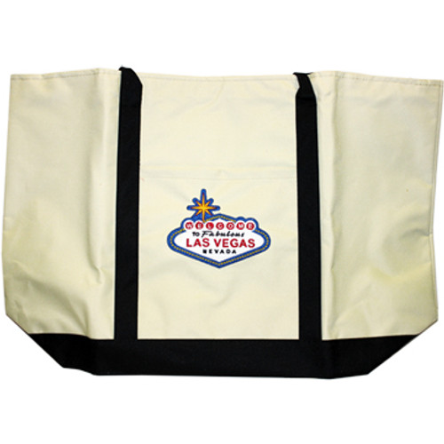 Cream colored Canvas Totebag with a Black Bottom and straps. There is an Blue, Red, and Yellow Welcome to Las Vegas Sign on it.