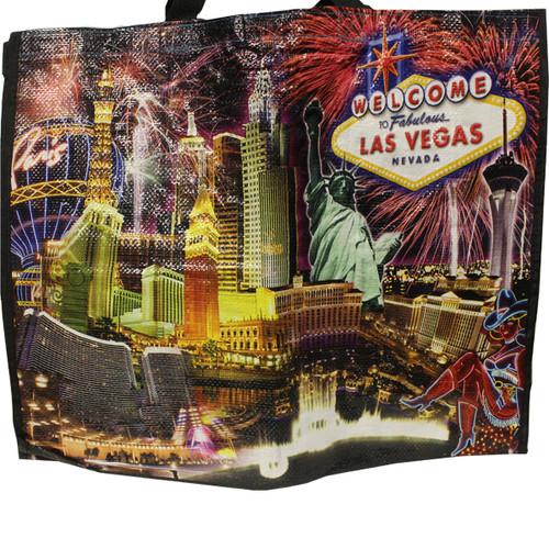 Black Night background tote bag has Fireworks bursting over Las Vegas Casinos in bright colors.