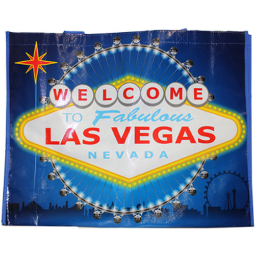 Blue background tote bag has a huge Yellow and Red colorful Welcome to Las Vegas Sign as the dominant focus on this item.