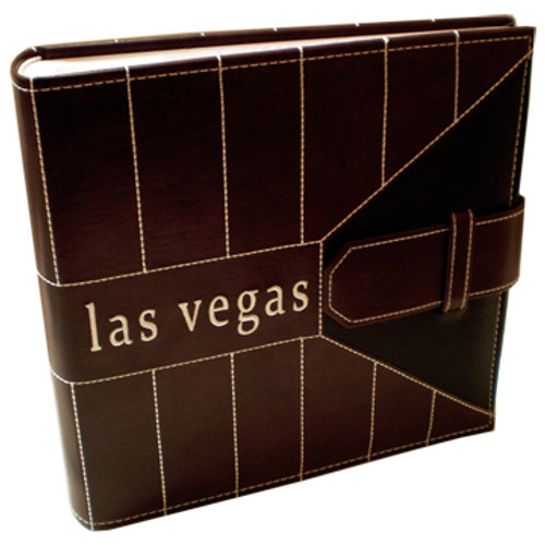 Brown executive look embossed large Photo Album has las vegas on the front and decorative masculine strips on it.