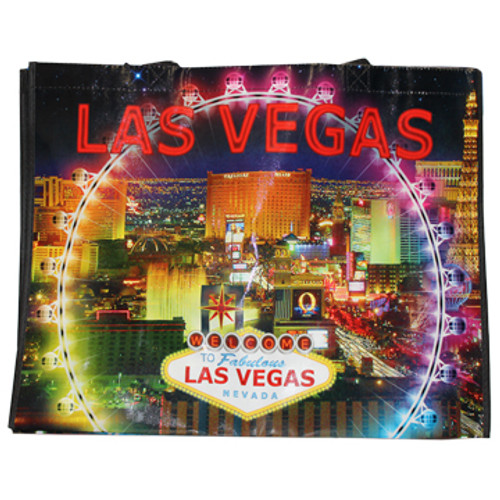 Black Night background tote bag with Las Vegas Casinos in bright colors like in real life in the background, the colors of the Hiroller attraction is center focus.