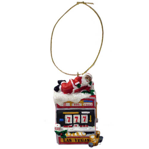 Acrylic Multi Colored Ornament that looks like a Slot machine with Santa laying across the top.