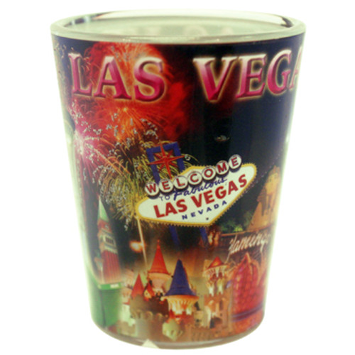 Glass Las Vegas shotglass with a full body black wrap background that shows all the popular Las Vegas Casinos with Fireworks exploding in the background.