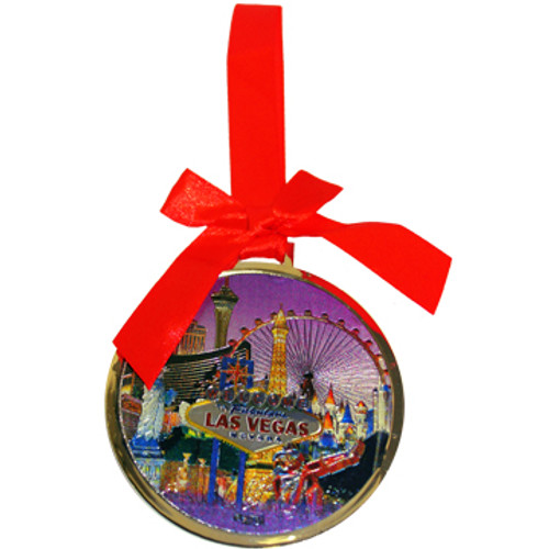 Round Metal Las Vegas ornament with a Red Ribbon and LV Purple Skyline Design in the Center- front side.