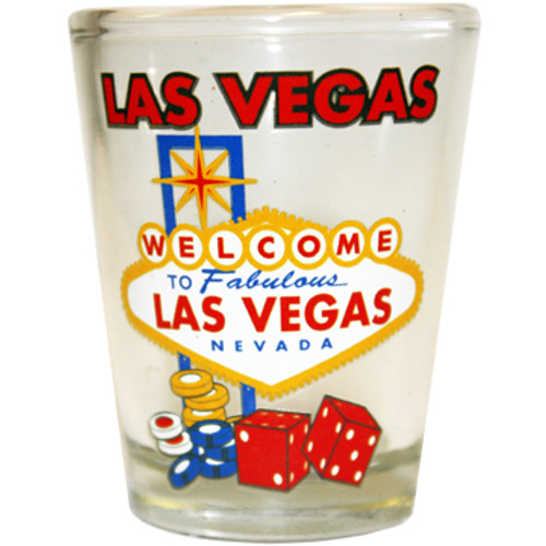 Glass Las Vegas shotglass with a design on the front which has a Colorful Version of the Las Vegas Welcome Sign, Dice, Poker Chips, and Las Vegas toward the top.