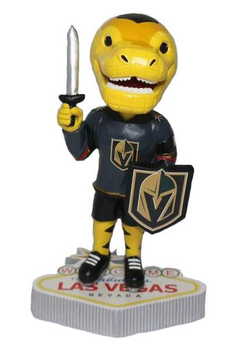 """Yellow """"Golden Knights-Chance"""" mascot bobblehead standing on the Las Vegas Sign."""