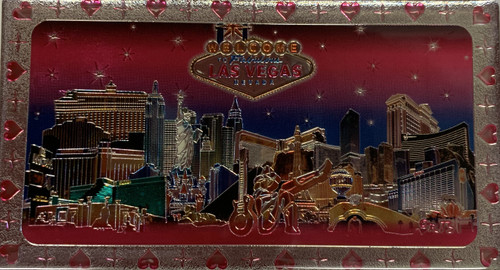 Metallic Magnet from Vegas With Pink Skyline Design on it.