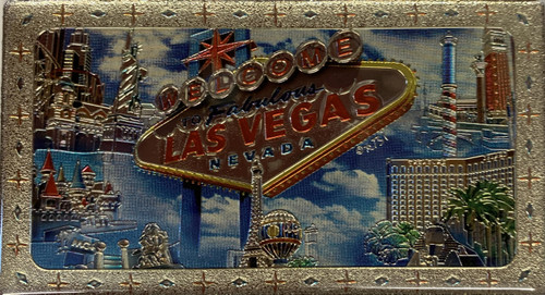 Metallic Magnet from Vegas With Blue Clouds Design on it.