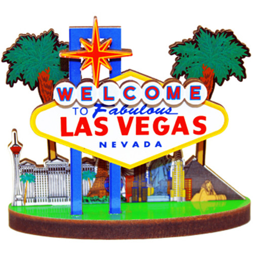 Wooden cutout 3-d colorful magnet featuring the Las Vegas Sign and City Behind it.