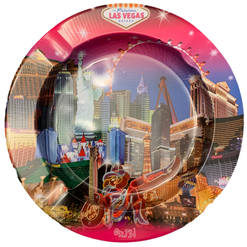 Round Tin ashtray with a bright Pink Las Vegas Skies design on it showing iconic casinos and landmarks.