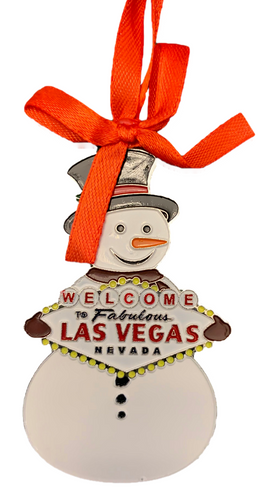 Metal Las Vegas Snowman Shape ornament that also has the Las Vegas Welcome Sign; with a Red Ribbon.