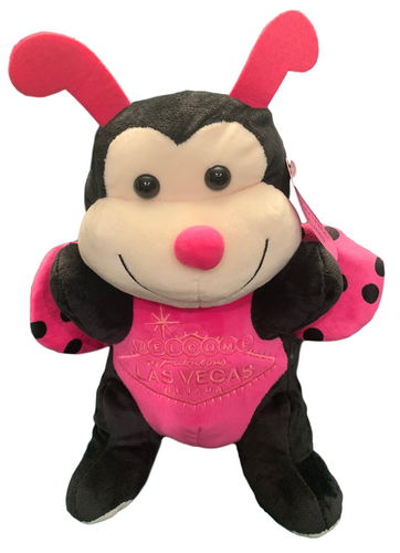 Front View of Black and Hot Pink plush Las Vegas LadyBug with welcome sign embroidered on its tummy.