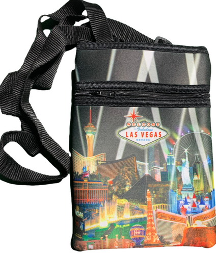 Black smaller disco purse with a Las Vegas City Icons and Casinos with a Spotlights shining over the city design.
