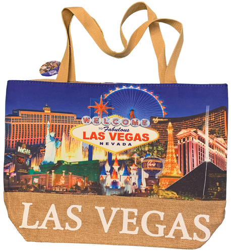 Printed canvas totebag has a straw bottom. Design is of the famous Las Vegas Strip with a Blue Background.