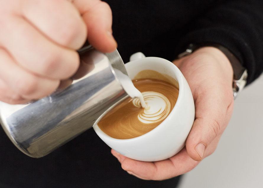 Pouring a Dot to begin a tulip latte art design