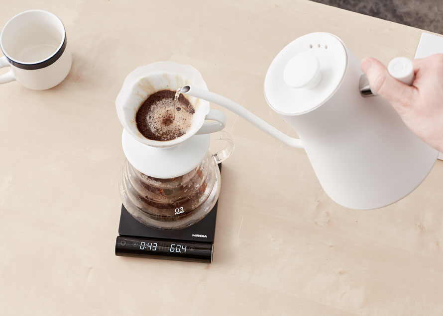 A brewing V60 with Stagg EKG and Hiroia Jimmy