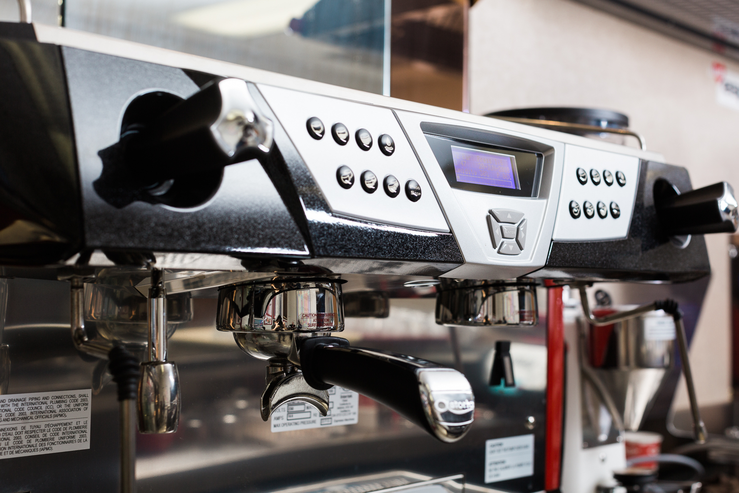 Espresso flowing from an Astoria Rapallo group