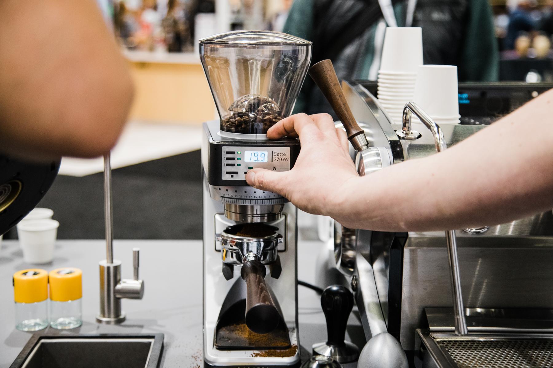 A Baratza Sette 270 W i being showcased beside a Slayer Espresso Machine at the 2018 Coffee Expo.