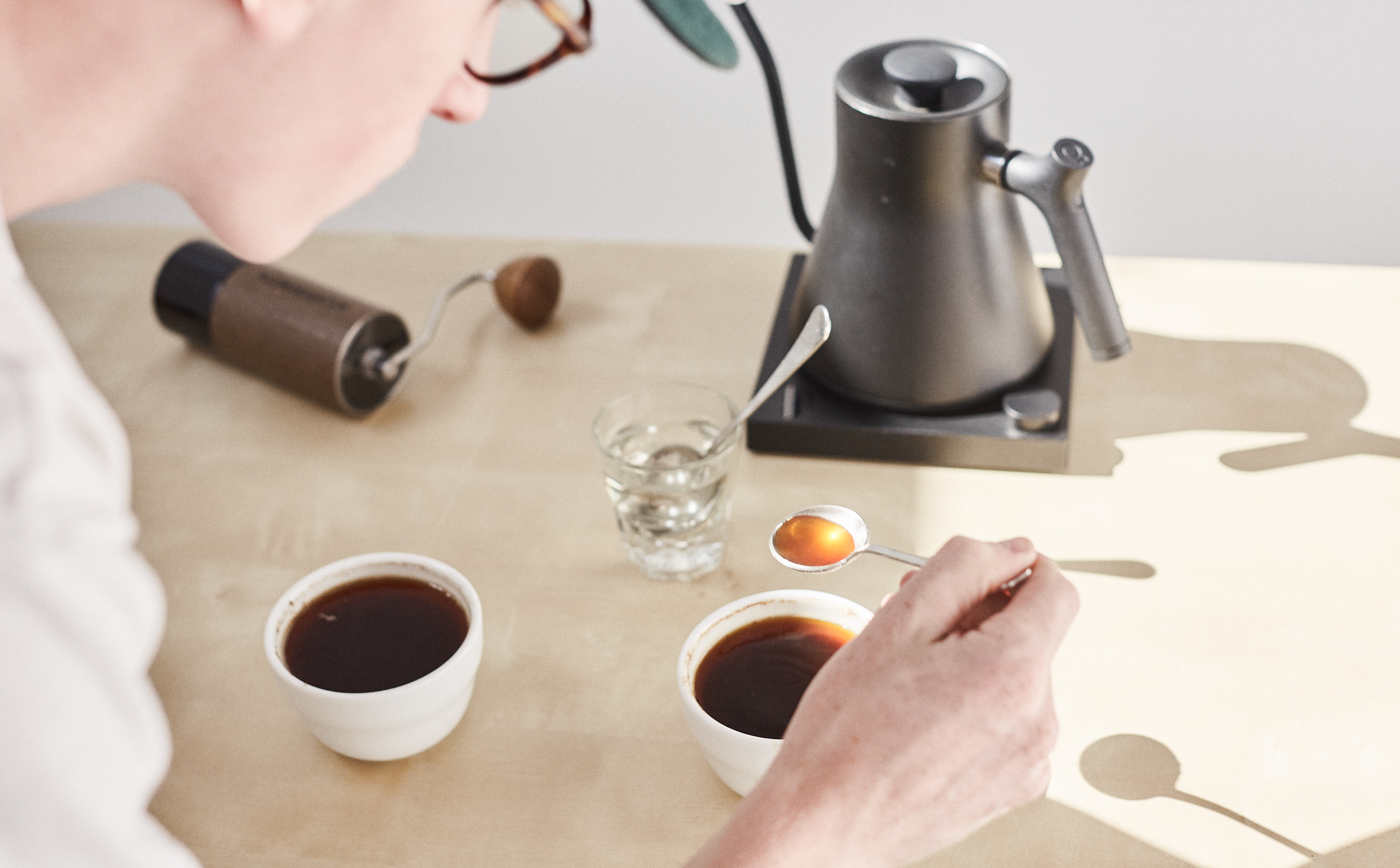 cupper tasting coffee from a spoon