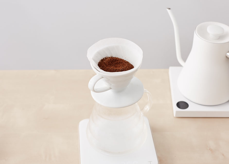 Ground coffee waiting to be brewed in a Hario V60