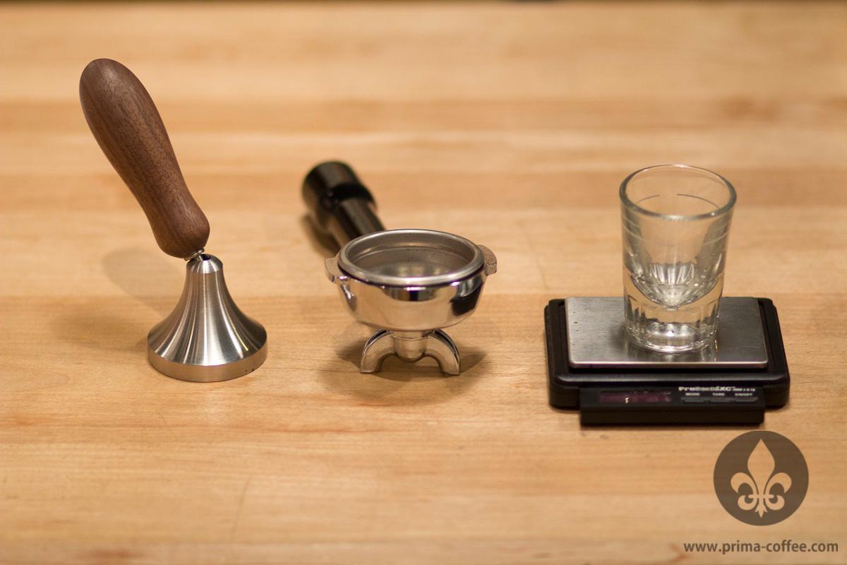 Espresso accessories: tamper, portafilter, shot glass, scale