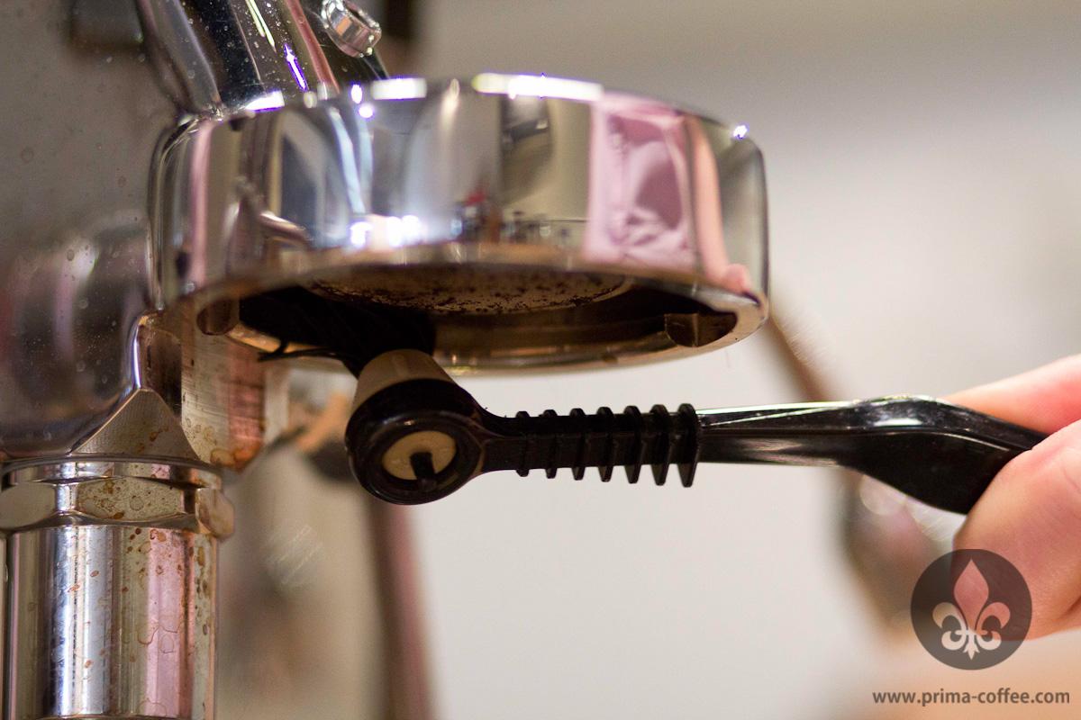 Scrubbing the espresso machine group