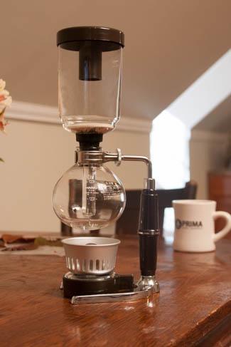 Siphon brewer with butane burner and Prima Coffee diner mug