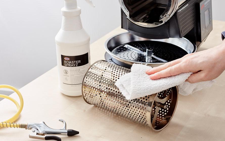 Wiping down the roaster drum with Urnex Roaster Sprayz