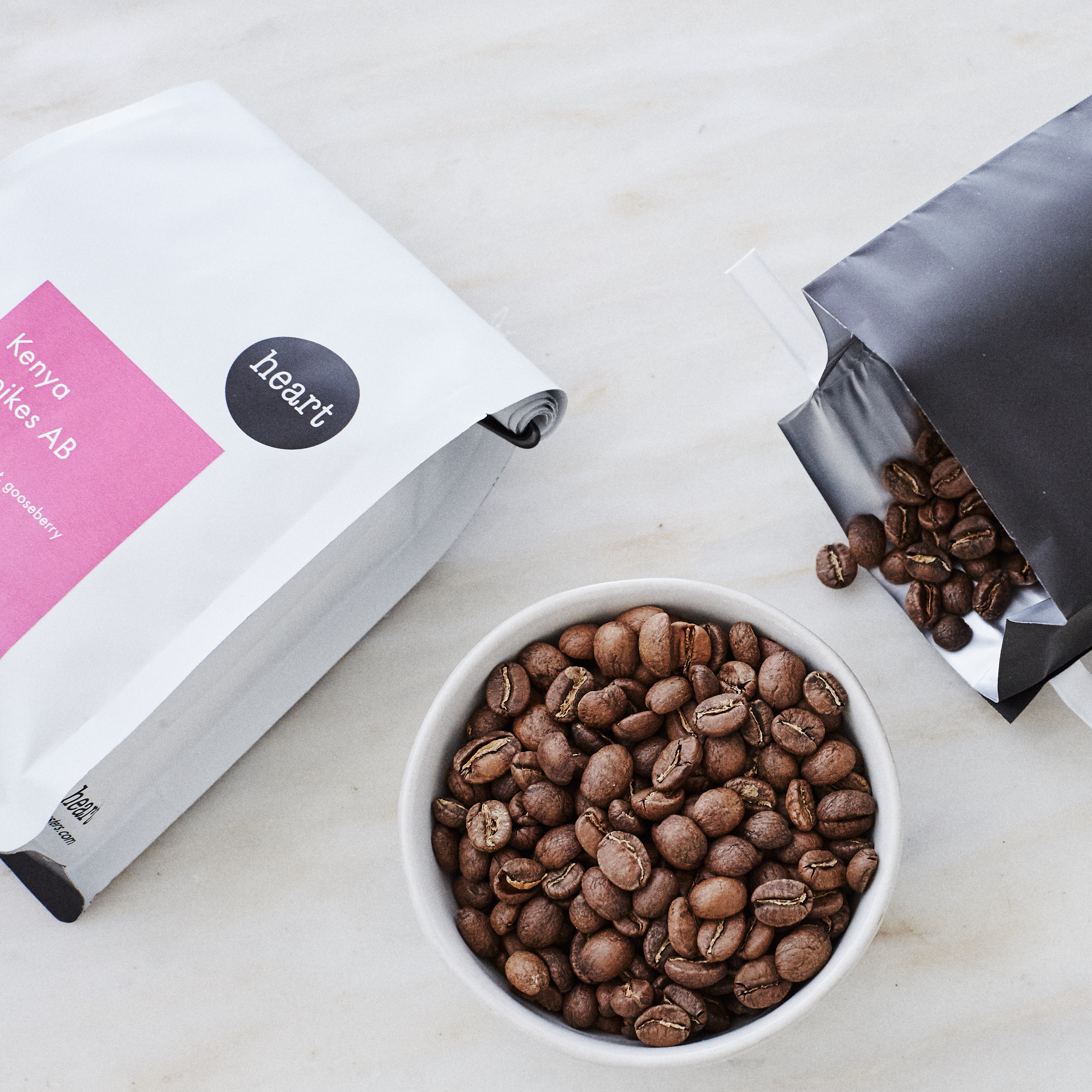 Coffee beans with retail bags of coffee