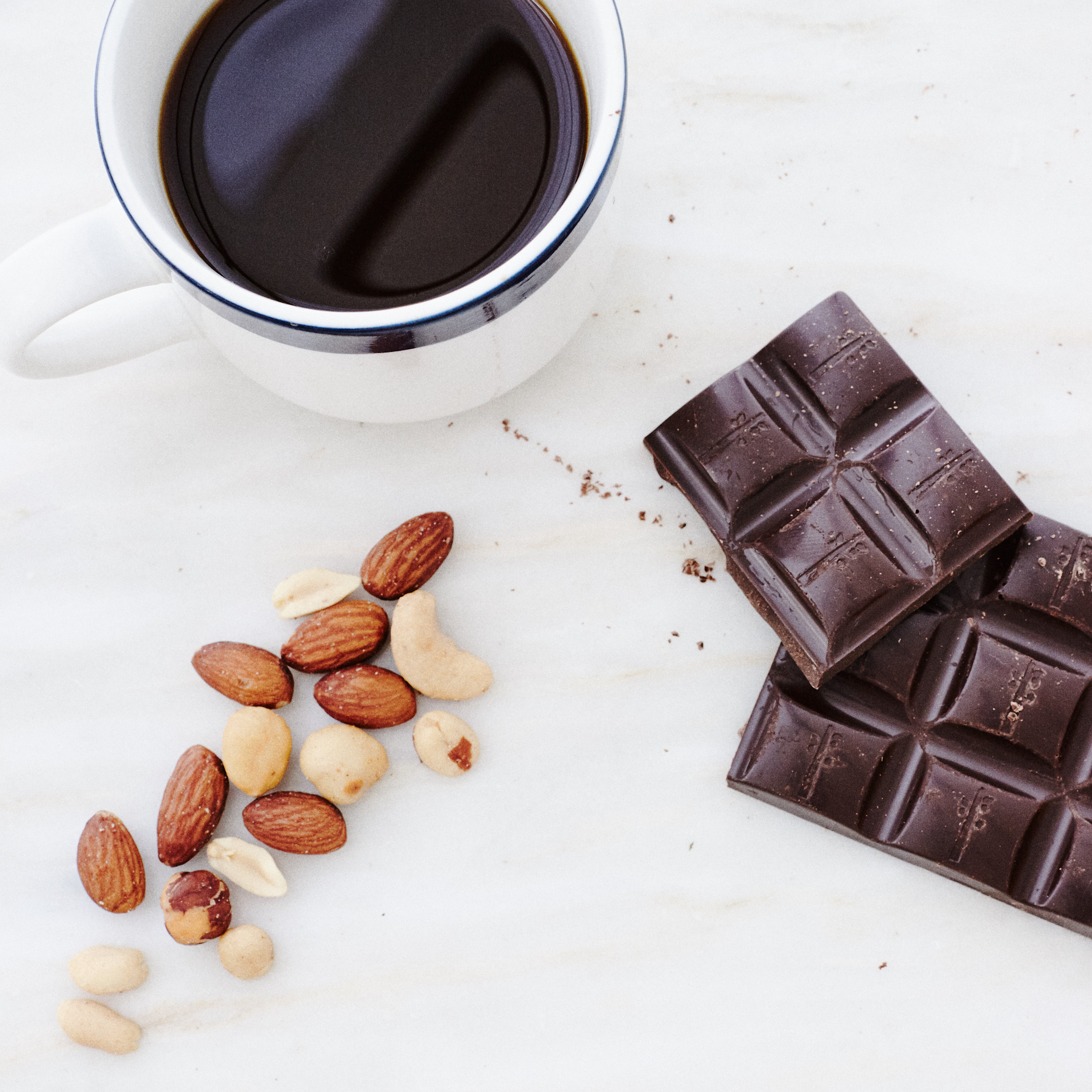 Cup of coffee with nuts and chocolate