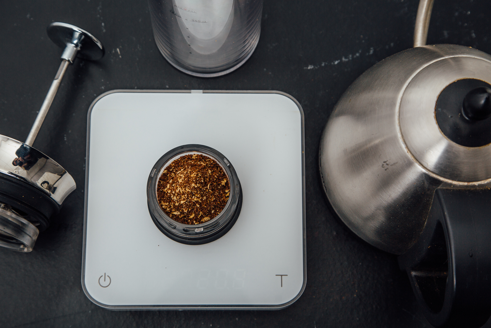 Preparing an American Press brew with a scale