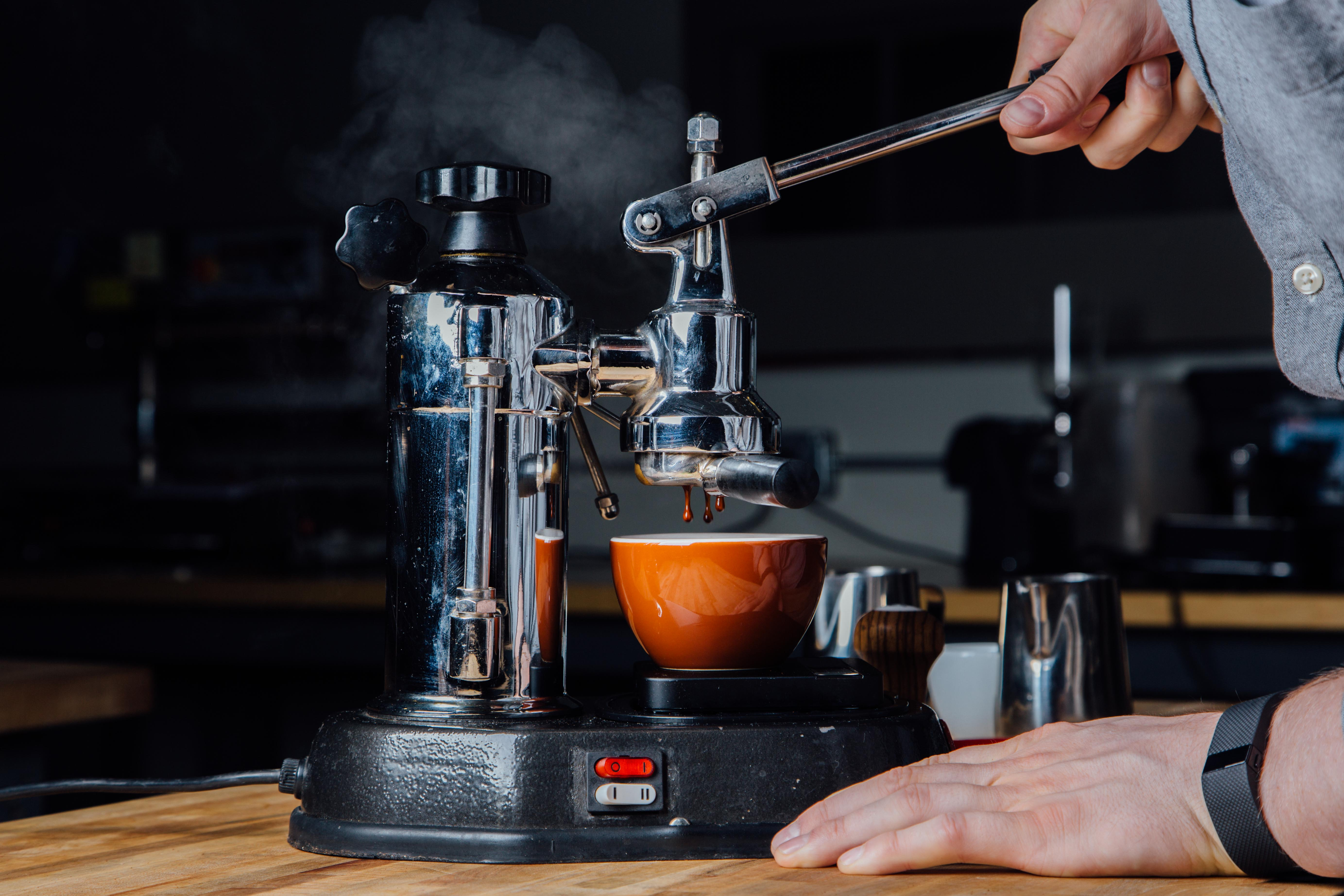 Pulling a shot with a vintage La Pavoni is a physical and steamy event.