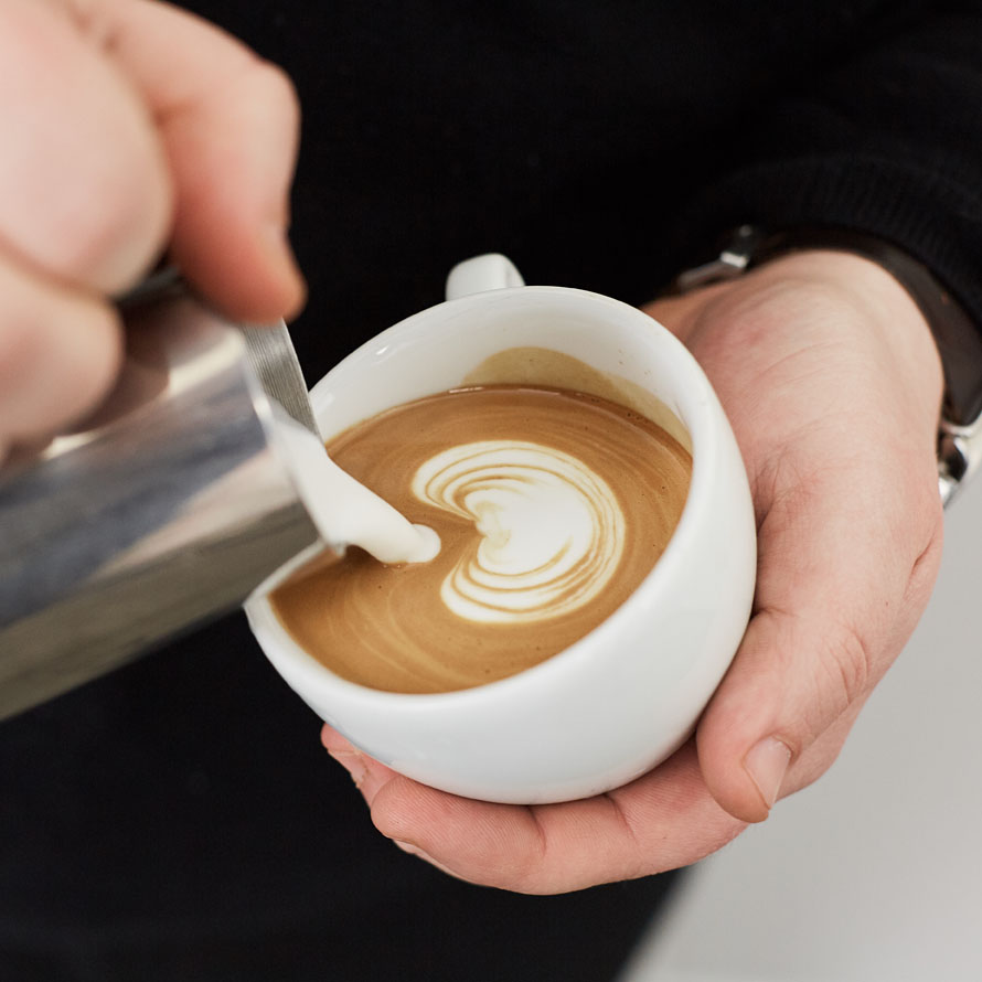 Leveling the cup out to keep pouring clean shapes in latte art