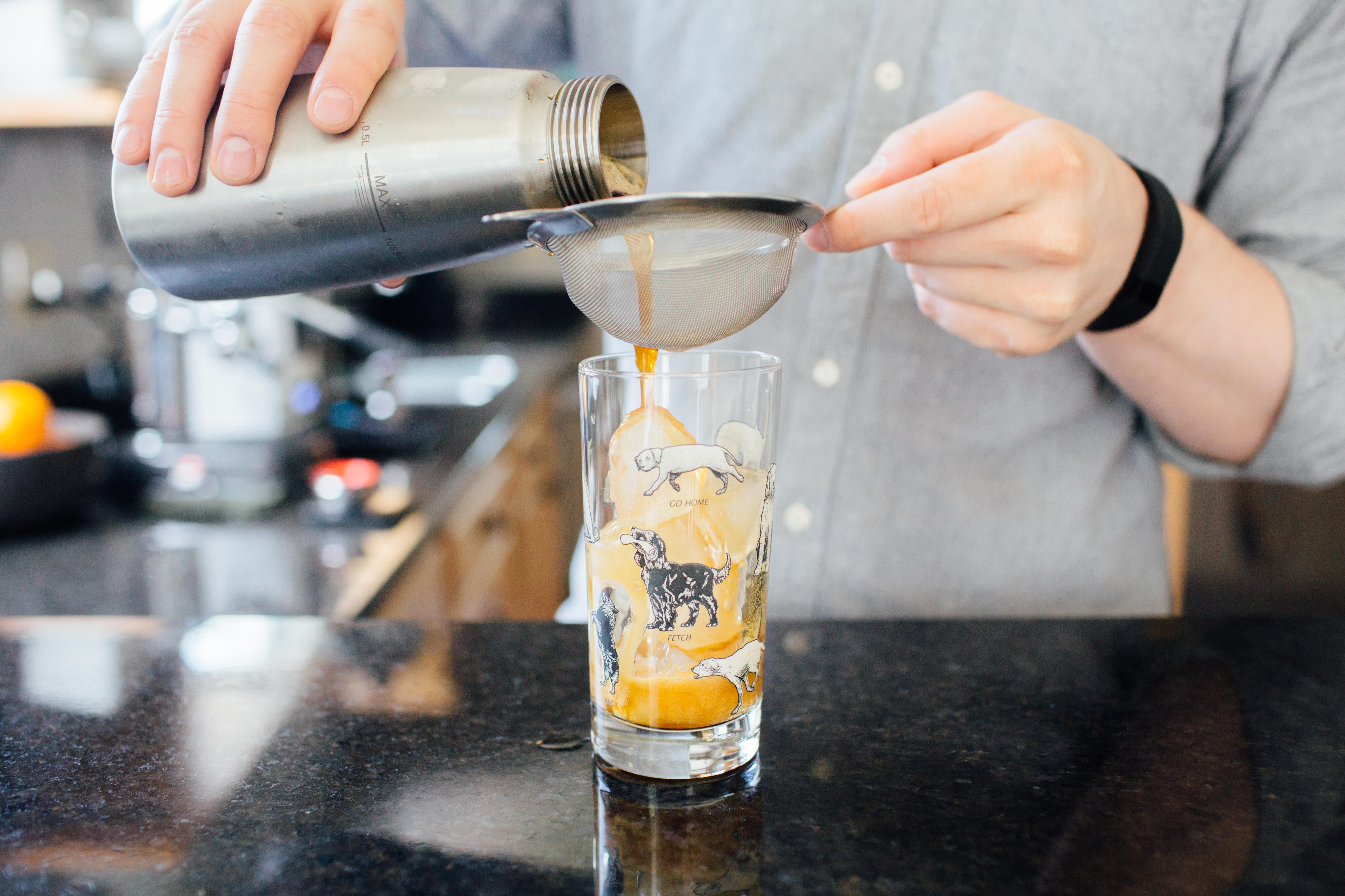 Strain the coffee soda into a glass