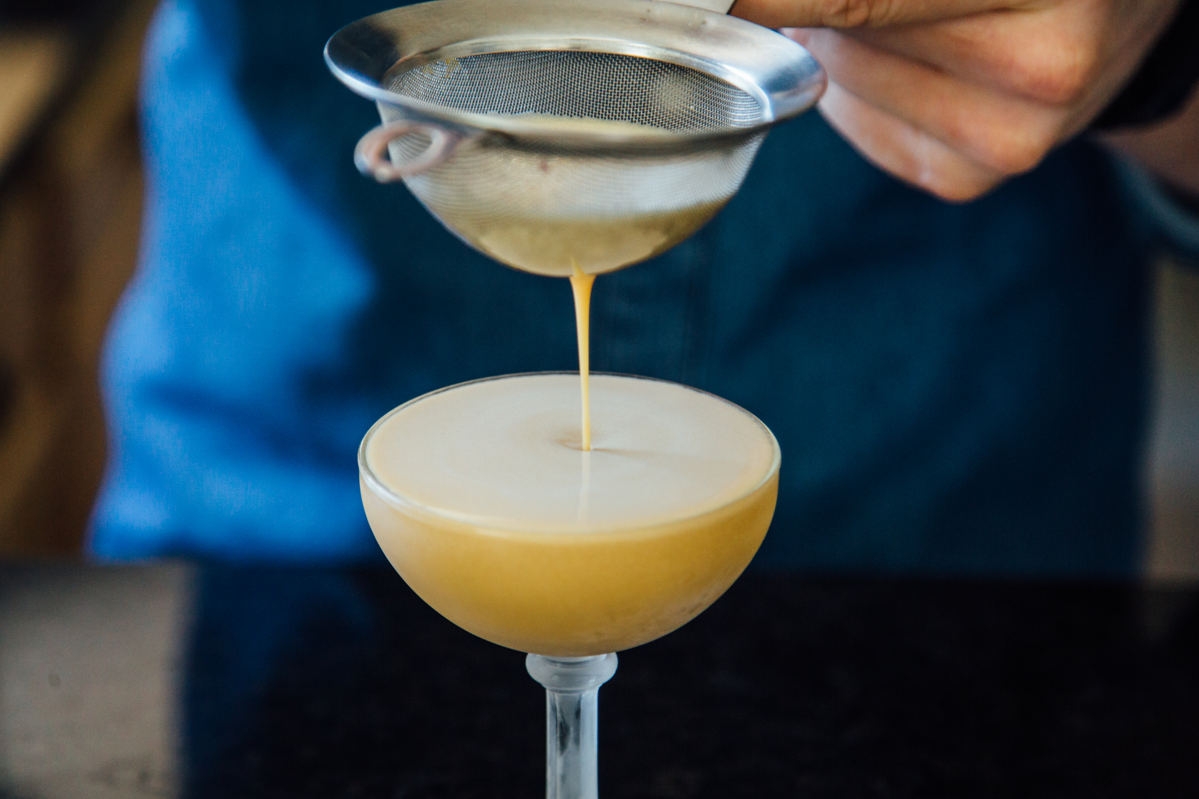 Double straining the whisky sour
