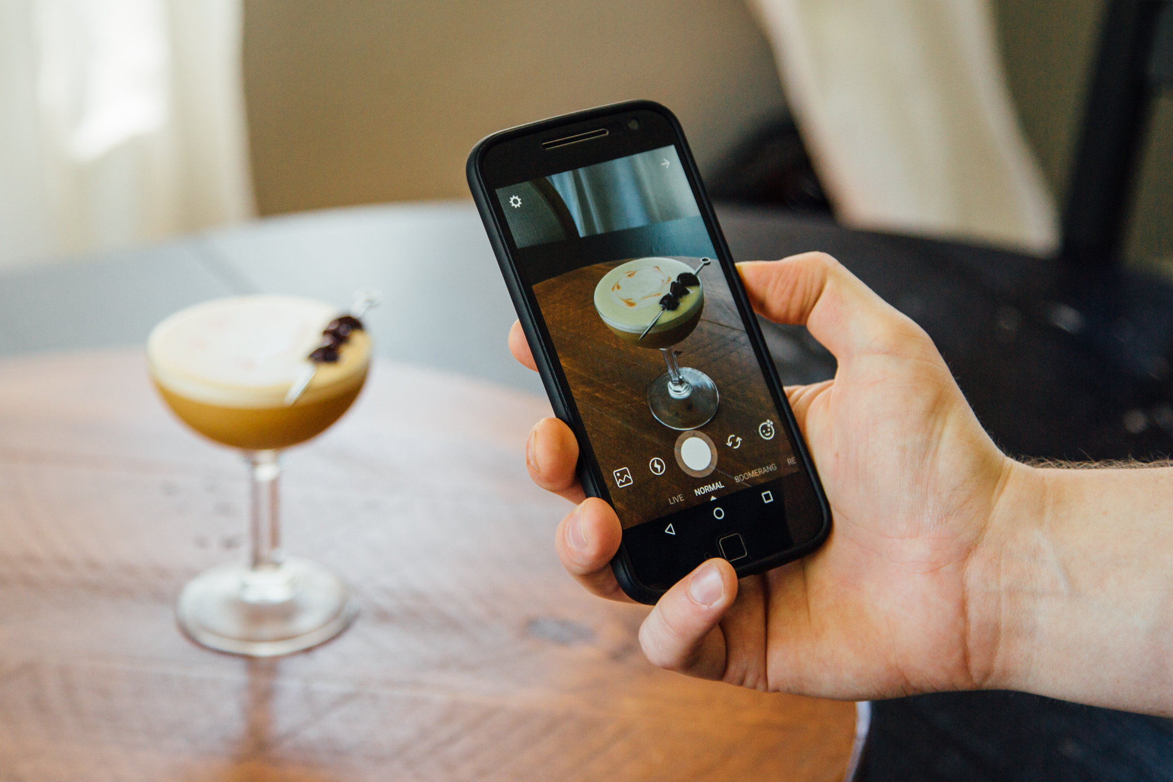 Taking a photo of a cocktail