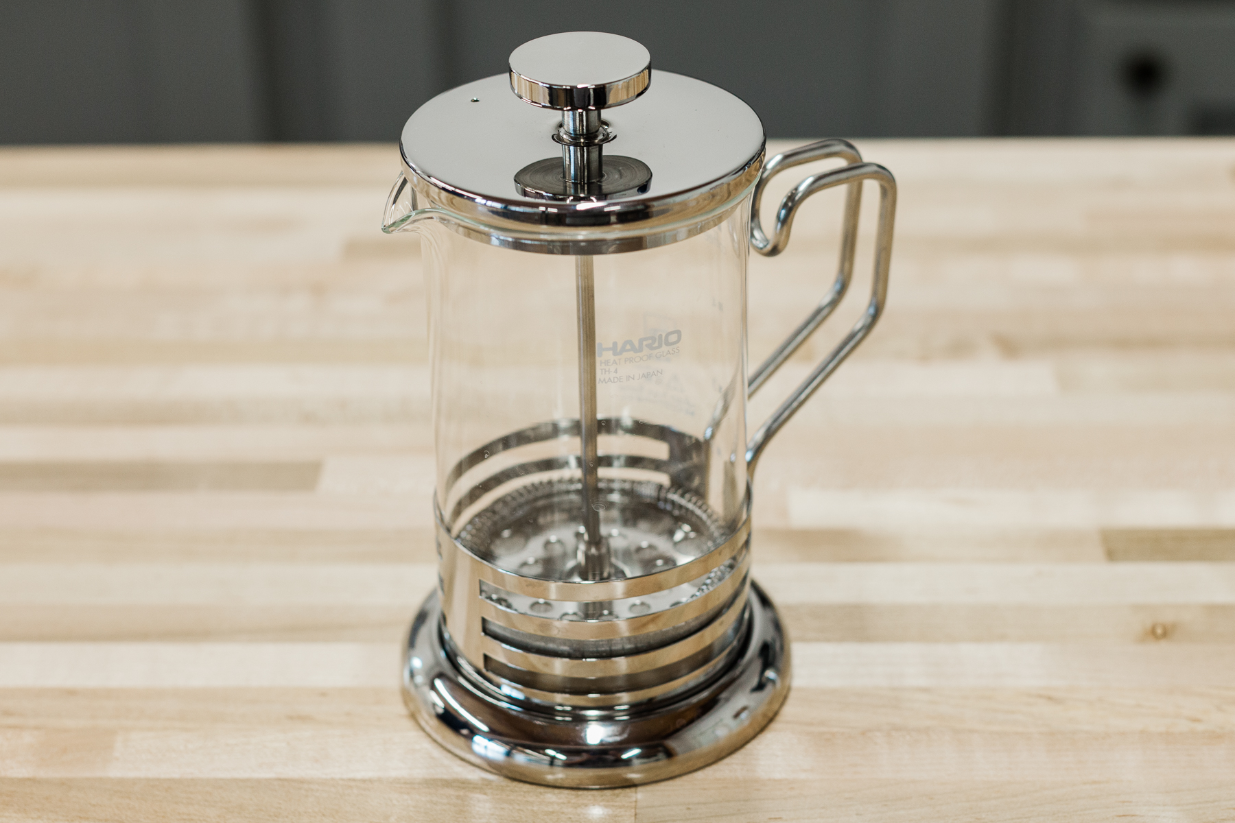 600 milliliter single-walled, glass Hario French press with metal accents.