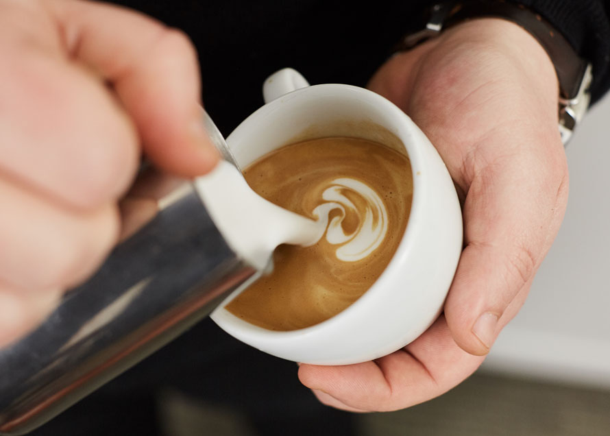 Pouring wiggles in latte art to make a rosetta design
