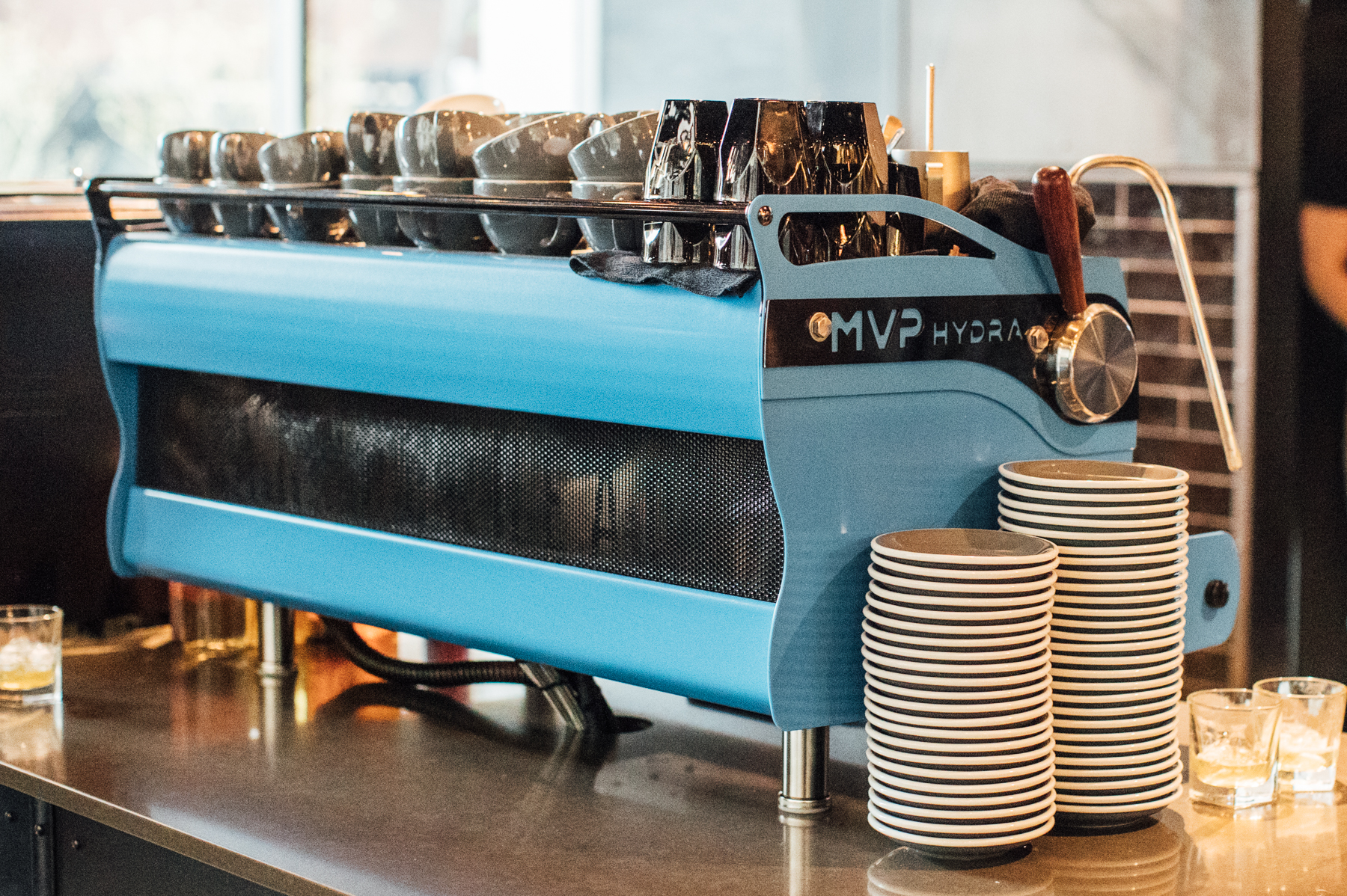 The backside of a blue Synesso M V P Hydra at Anchorhead Coffee in Seattle, Washington.