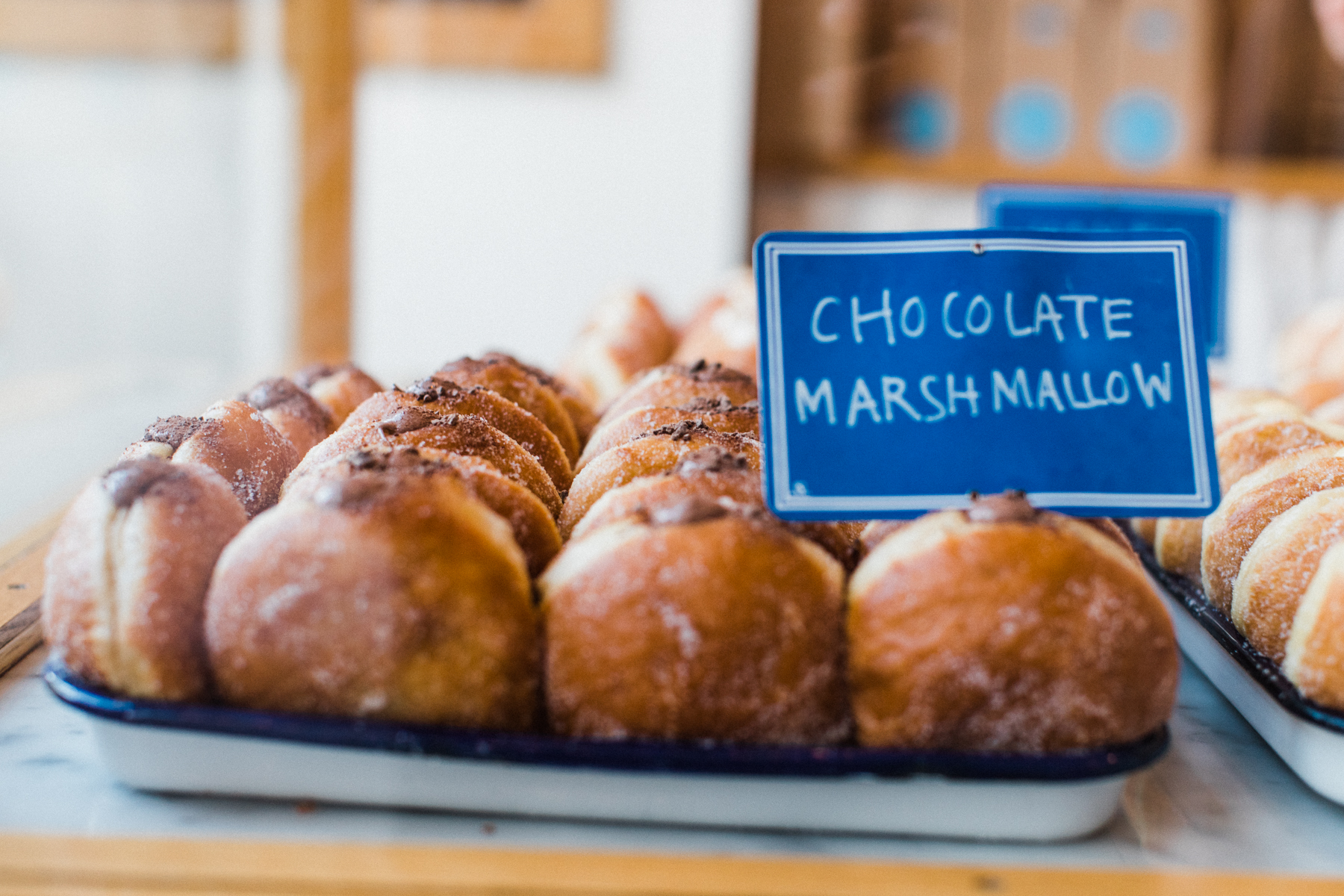 A tray of chocolate marshmallow filled doughnuts at General Porpoise Doughnuts in Seattle, Washington.