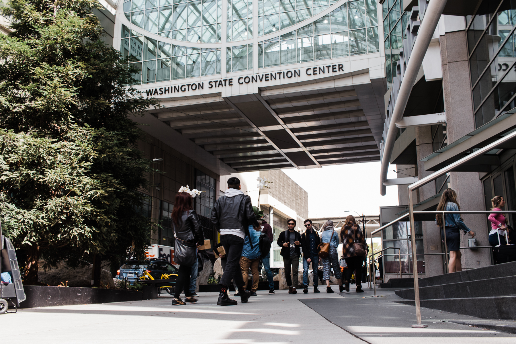 People walking into the Washington State Convention Center in Seattle.