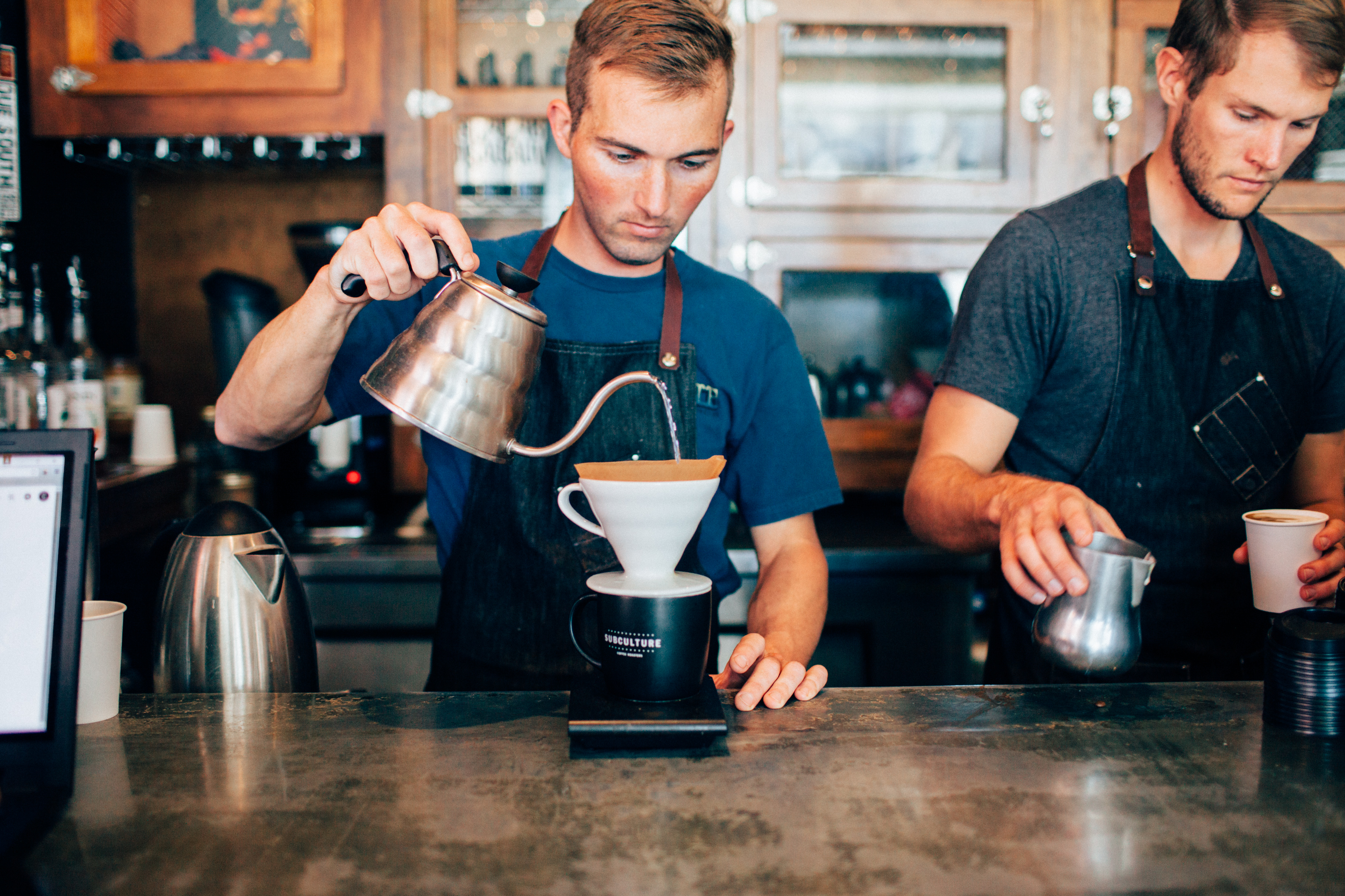 Brewing pour over coffee in a cafe
