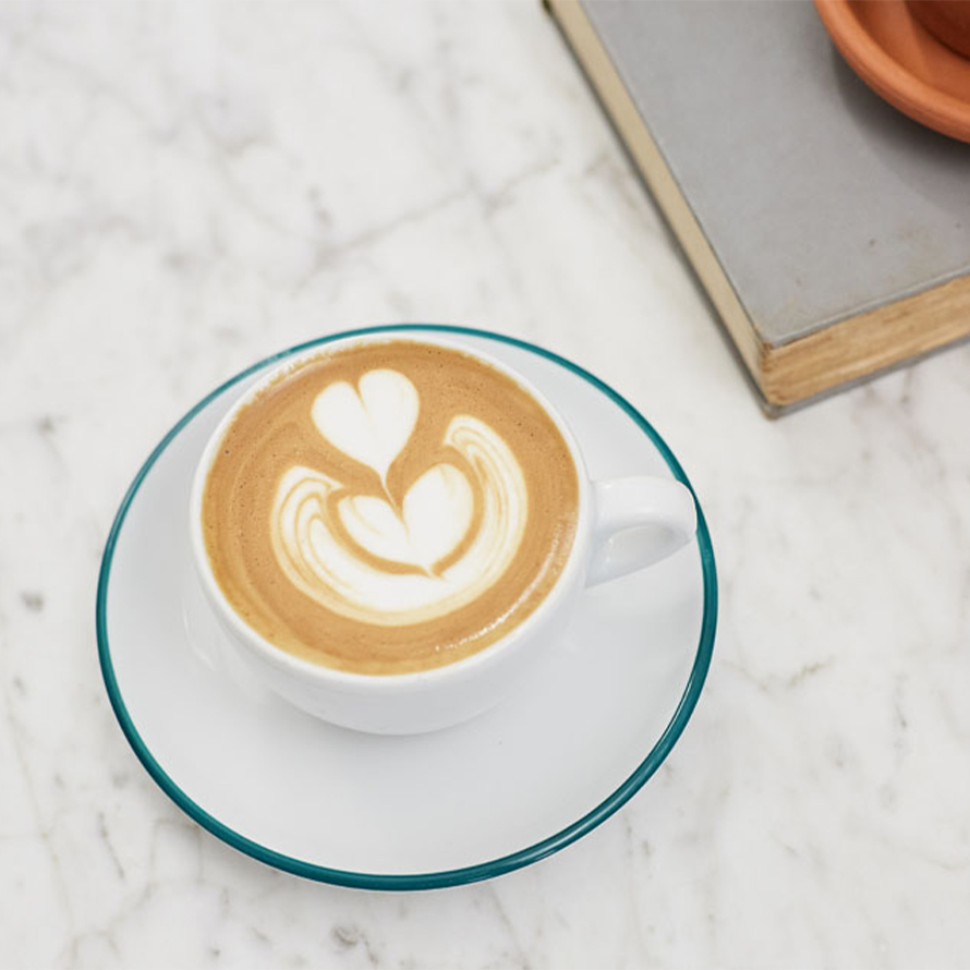 A three tier tulip latte art design served in white ceramic