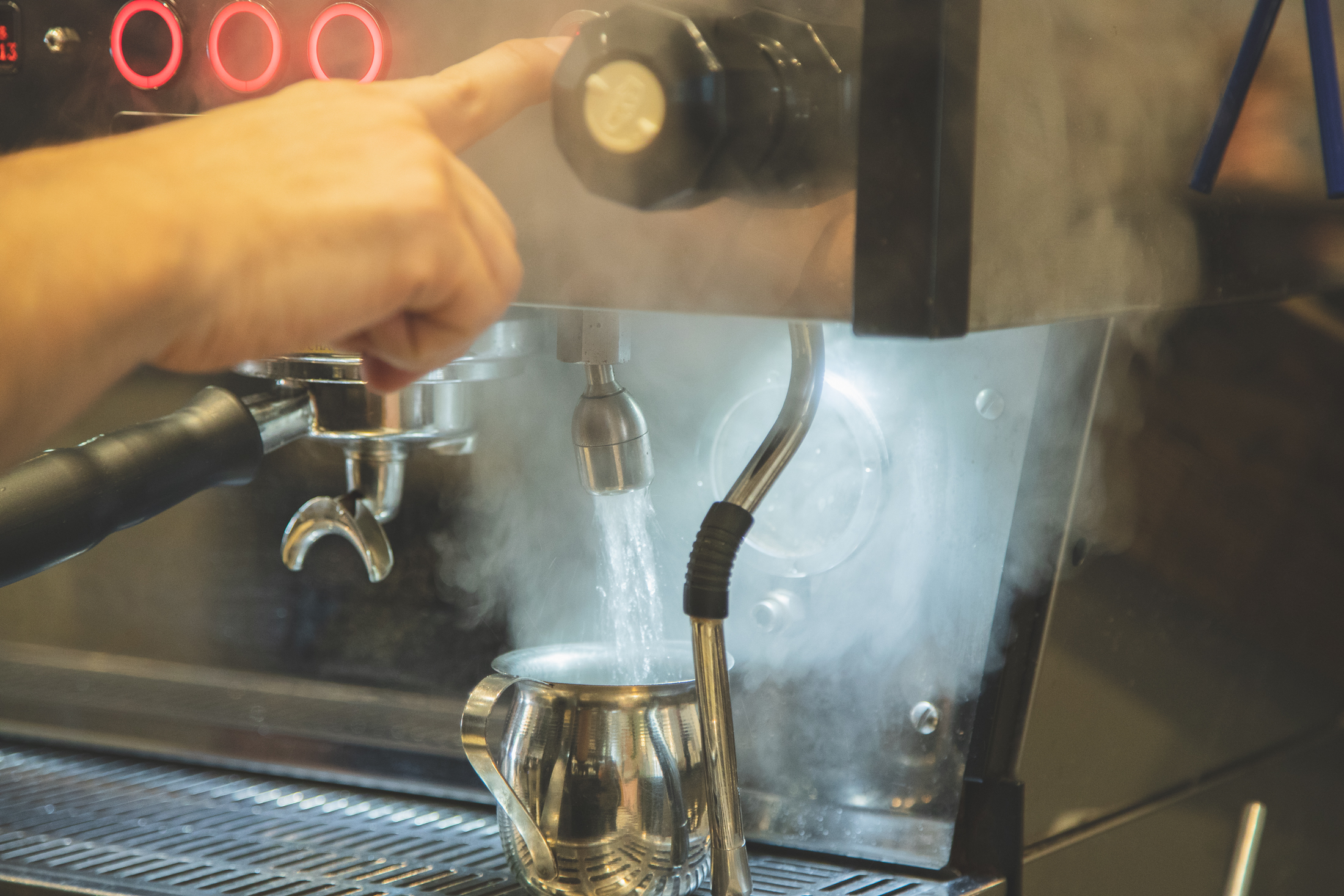Water coming from a hot water tap on a La Marzocco Espresso Machine.
