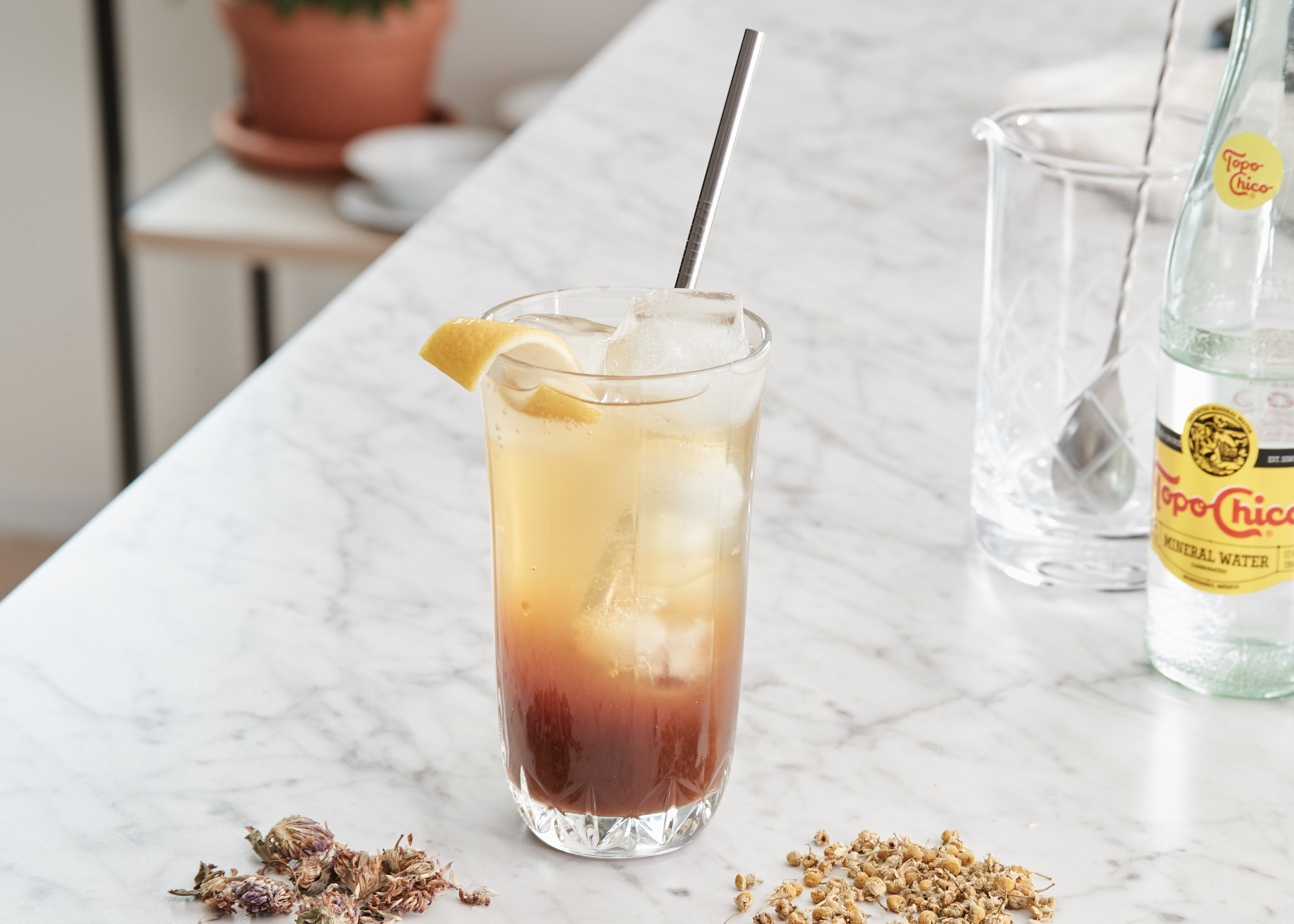 Wildflower Coffee Soda, with chamomile and red clover, topo chico, and mixing glass