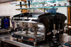 2 group Astoria Gloria A L Lever Espresso Machine on a stainless steel table
