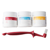 Urnex espresso cleaning kit, including Cafiza, Grindz, Rinza, and the Scoopz grouphead cleaning brush.